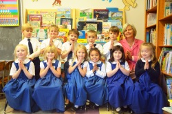 Kindergartners pose for a picture with Mrs. Gallaher.